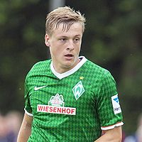"""Kroos has made quite the impression on coach Pep Guardiola, underlining his importance to the club by playing in all but one of Bayern's 30 competitive outings so far in 2013/14, but according to SV Werder Bremen youth  coach Dieter Eilts, there's an even """"better Kroos""""  Felix (right), who also came through the youth ranks at Hansa Rostock. He is yet to match his brother's achievements, though, scoring just once in 24 appearances for current club Bremen"""