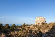 completed in 1763, the \'pi des català\' tower is one of four defensive lookout structures on the coast of formentera, the smallest of spain\'s balearic islands.