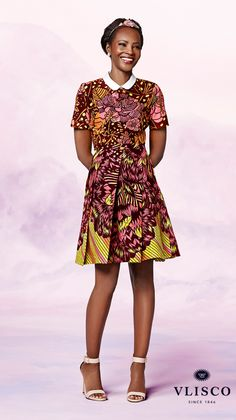 TOP OF THE CLASS | This sweet, stylish dress is great for accentuating your waist. The fitted top and voluminous skirt gives the silhouette a... | Vlisco