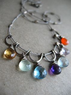 https://flic.kr/p/998cov | Fiesta Necklace | I just love all these stones together! Citrine, prasolite, blue topaz, amethyst, green amethyst, pink amethyst, and a punch of carnelian (with  hand-formed sterling silver and silk cord).