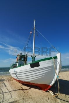 A photo of a Danish fishing boat at the beach photo