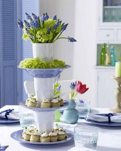 spring table centerpieces tower plates glasses flowers grape hyacinth