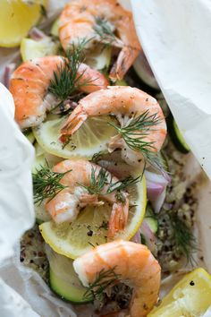 Shrimp & Rainbow Quinoa en Papillote _  This is simple to put together, but complex in it's flavors. The lemon & dill are incredibly aromatic, & the olive oil & butter blend together to create a luscious sauce that flavors the entire dish perfectly. Topped with juicy & tender shrimp, this meal is a show stopper! #Shrimp