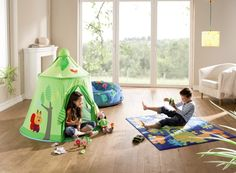 This playroom just became MUCH more playful with this tent, play rug and toys from @habausa! #PNpartner