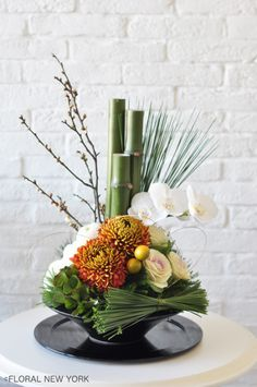Japanese new year's decoration - orchids, galax leaves, bamboo Ikebana Arrangements, Tropical Flower Arrangements, Creative Flower Arrangements, Ikebana Flower Arrangement, Artificial Flower Arrangements, Beautiful Flower Arrangements, Beautiful Flowers, Exotic Flowers, Purple Flowers