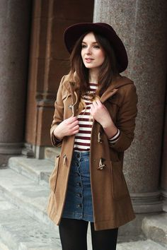 Shop this look on Lookastic:  https://lookastic.com/women/looks/duffle-coat-crew-neck-sweater-button-skirt/15271  — Burgundy Wool Hat  — Brown Duffle Coat  — Red and White Horizontal Striped Crew-neck Sweater  — Blue Denim Button Skirt  — Black Wool Tights