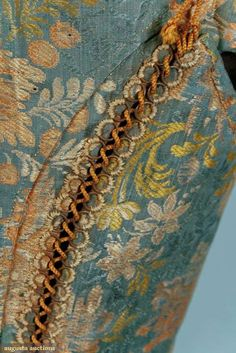 Lacing Detail showing the Metal Rings, mid-to-late 17th century. This makes me think differently about my lacing rings.