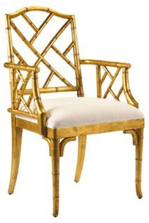Moselle Armchair, Gold Leaf/Sand Taking its cues from Chinese Chippendale style, this armchair is crafted of fine-grained, durable mahogany carved to mimic bamboo and given a lustrous gold-leaf finish.