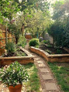 secret garden raised beds or pots/containers on each side of the walk way... possibly to the back yard