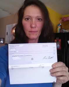 Melody L. with her Vindale check payment