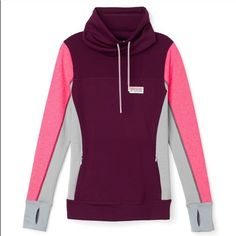 Medium PINK Ultimate High Neck Pullover The colorblock craze continues with this pullover featuring a drawstring neck and slight high-low hem. Only by Victoria's Secret PINK  Slim fit Print graphics Premium stretch fabric that smooths and flatters Pockets Thumbholes Imported polyester/spandex PINK Victoria's Secret Sweaters