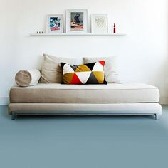 A mid-tone retro blue-green shade of vinyl flooring