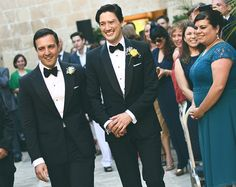 "These grooms chose classic black dinner suits for their recent wedding. Ideal for the big day, a bespoke dinner suit is also a dress to impress investment for black tie and formal events.  Of their experience, Dan & Liam said ""Thanks again for your stellar help with our suits; we will be putting them on again to the opera next week."" Smart in every way."