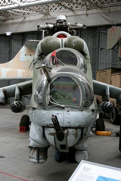 "Go Ugly; Mil Design Bureau Mi-24 Hind ""D"" awaiting restoration in Duxford, UK."