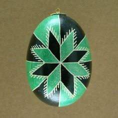 Pysanky from all regions of Ukraine depict an eight-sided star, the most common depiction of the sun.  Green is the color of fertility, health, and hopefulness; of spring, breaking bondage, freshness, and wealth. In the Christian era it represented bounty, hope, and the victory of life over death.