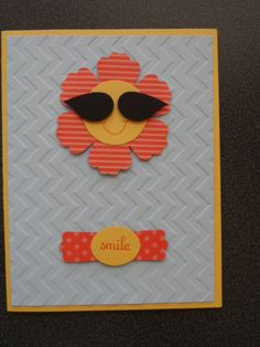 "Isn't it amazing what a few punches can create?      Supplies:    Fabulous Phrases    Daffodil Delight cardstock    Tango Tangerine marker and ink pad    Brights assorted designer series paper    Basic Black cardstock    Bashful Blue cardstock    Chevron embossing folder    Bird Builder punch (for the sun glasses)    1 1/4"" circle punch    Small oval punch    Blossom punch    Modern label punch    Dimensionals"