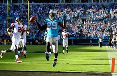 CHARLOTTE, NC - NOVEMBER 03: Drayton Florence #29 of the Carolina Panthers high-steps into the end zone for a touchdown after intercepting a pass by quarterback Matt Ryan #2 of the Atlanta Falcons during the fourth quarter at Bank of America Stadium on November 3, 2013 in Charlotte, North Carolina. The Panthers won 34-10. (Photo by Grant Halverson/Getty Images)