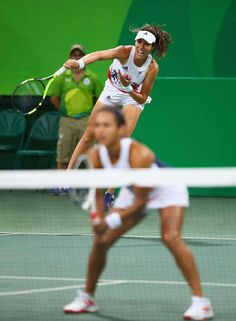 Heather Watson looks on as Johanna Konta of Great Britain serves during the Women's Doubles second round match against HaoChing Chan…