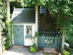 Childrens cottage playhouse with lollipop fencing