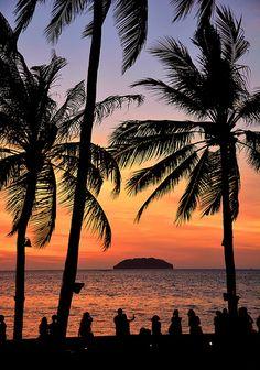 Sunset through the palms at Tanjung Aru, Kota Kinabalu.