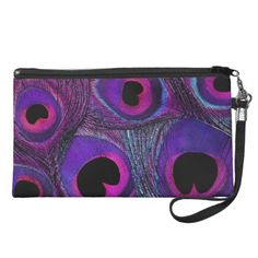 This customizable clutch sized wristlet bag features a peacock feather print in deep, rich shades of violet, purple, hot pink, black, and a touch of aqua. Perfect for nights out when you only want to carry essentials or as a bridesmaids or attendants gift. Can be easily personalized with a monogram, or other text -- simply add text in your favorite font and color. This same peacock feather pattern is also available in other color combinations and other matching, customizable items.