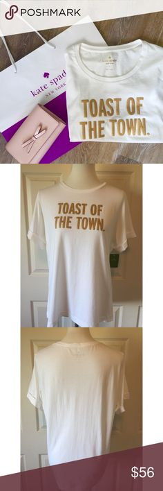 """KATE SPADE TOAST OF THE TOWN TEE♠️️ ♠️️Kate Spade """" Toast Of The Town"""" Tee. NWT. White with glitter gold Signature writing Size Large: 42"""" bust, 25"""" length, 8"""" cuffed sleeve fabric: 100% cotton NWT $68.00 plus taxNO tradesSmoke free homeBundle discount: 10% off two, 15% off threePlease visit our wonderful friend Molinda @molinda25 to find more Kate Spade beauties and many other treasuresThank you for stopping by kate spade Tops Tees - Short Sleeve"""