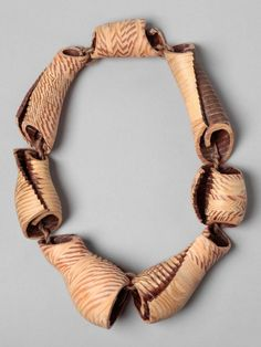 Nadya Fedotova, CNC Driftwood , BA 2014, necklace, CAD design, spruce wood, cotton cord, aluminium, 310 x 220 x 60 mm, photo: Nadya Fedotova