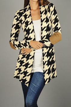 Houndstooth black and white cardigan with khaki elbow patches. {$37 shipped, S-M-L} Purchase here: https://www.facebook.com/photo.php?fbid=10153929480313686&set=pcb.1051630641562878&type=3&theater