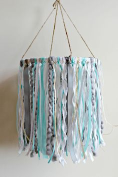 Mobile in white, mint, grey, gold and silver This stunning mobile is packed full of cotton, yarn fibers and ribbon. Pictured mobile measures 10 across hoop Each piece of cotton and ribbon hangs approx 12 long. Measures approx 27 in length including the twine hanger. So soft and dreamy! Perfect for a little boys nursery. It will add the perfect finishing touch to any occasion or special space in your home! Mobile is made to order PLEASE see current processing times in my shop announceme...