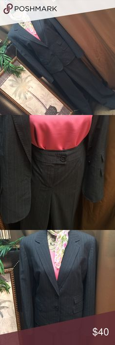 Jones New York Pants Suit Gray pinstripe suit is boardroom ready and great pre loved condition. Material content 65% polyester 33% rayon 2% spandex. Pants are single buttoned with functional side pockets. Very nice suit for many functions types. Jones New York Pants