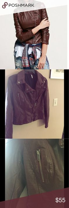 Free People Faux Leather Jacket Super loved! Has 2 minor flaws, just some leather discoloration along the jacket and has a scratch mark that is very, very small on the sleeve. (Both pictured) is a deep burgundy color that zips up! Has black interior and zipper details. Super beautiful & great for any fall or winter look. US size 6. Any questions? Comment! 💫✨🌙 Free People Jackets & Coats Blazers