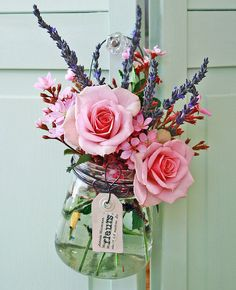 Mason Jar of roses and lavender. Would be lovely with some wispy white flowers to tone this down.