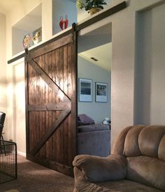 barn doors are perfect in areas of the home where there is limited space for a