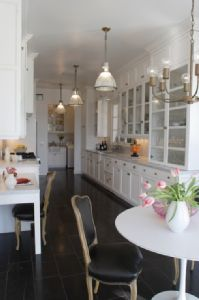 White galley kitchen....I don't like the cabinets that low, but I like how many drawers and cabinets there are.