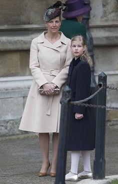 The Countess of Wessex sported a chic beige mac as she arrived at the church with her daughter Lady Louise Windsor who was dressed in a navy coat, white tights and silver shoes.