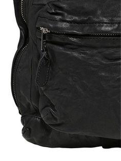 Height: 45cm Width: 31cm Depth: 17cm . Double adjustable shoulder straps . Leather top handle. Top zip closure  . Front zip pocket