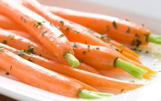 Sweet honey, tangy vinegar and rich butter provide a balanced glaze for carrots. This dish makes a colorful accompaniment to roast beef or chicken.