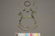 Bronze fittings and decoration of a coin purse found in Uppland, Sweden. Gravenumber bj949.
