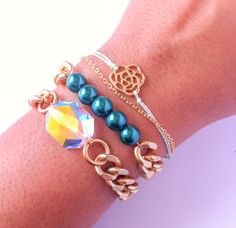 Fall in love with this pre-made arm candy set! All handmade by Molly+Maci.  Set Includes one Swarovski crystal bracelet, glass bead satin gold bracelet, and a dainty rosey bracelet.    *Product color and quality as seen on a monitor may vary slightly compared to actual items due to photograph...