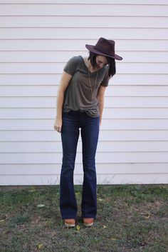 Blair of Wild & Precious is fall-ready in her on-trend flare jeans and a fall color palette.