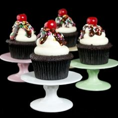 Moist Chocolate Cupcakes-creamy Vanilla Frosting, chocolate ganache, sprinkles & to top it all off-a maraschino cherry-who needs ice cream.