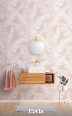 With plenty of dusty pink leaves and a pale peachy background, our Maranoa Pink wallpaper is the perfect pattern for creating a paradise at home. This wallpaper is made up of large hand-painted banana leaves, with gorgeous watercolor tones throughout. The design is finished off with a light papery texture on top, which adds to its natural feel. Maranoa Pink is designed to create a laid-back tropical vibe wherever you choose to place it.