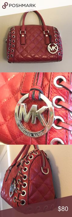 Michael Kors red quilted handbag This MK handbag is so cool! Quilted with laced sides and silver hardware. This purse is pre loved. Has scuffing on the silver drop logo. Red leather is fading on the handles, laced strands and near the top by zipper. Mild spots on the bottom. Interior is spotless 😁 No major damage or wear, just what is typical from being used. Wanted to make sure I disclose all known flaws! Please see photos for details and ask any questions prior to purchase :) measures…