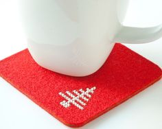 Christmas DIY Coaster Kit - Cross Stitch Felt Coaster Set with Modern Christmas Tree Pattern. $24.00, via Etsy.