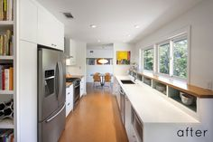 """love how the dishes are kept underneath the windows on shelves. adds more """"cabinet"""" space while making it look clean and open."""