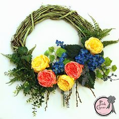 English Garden Wreath.  Great pops of color for your front door.  A wreath that can't be missed!