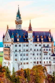Ultimate Travel Bucket List: 20 Incredible Experiences | Sunday Chapter  VISIT NEUSCHWANSTEIN, A FAIRY-TALE CASTLE IN GERMANY