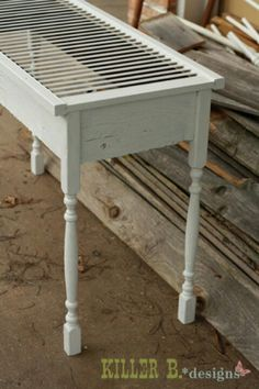 Shutter used as a table top. This would be great with a piece of glass over it!