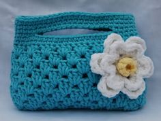 I love this bag just as it is. The only changes, bulky weight yarn and a 5.00mm hook. Find the pattern tangledhappy.blog...
