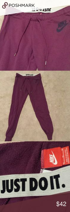 Price firmNike sports rally Maroon colored sports rally straight leg cuffed sweat pants with the just do it fold down waist band. Size medium. Super cute and very comfy. Nike Pants Track Pants & Joggers
